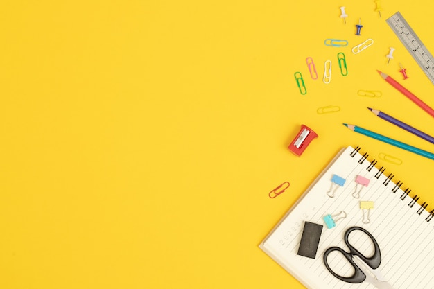 3 colored sticks placed with various art supplies on a yellow background.