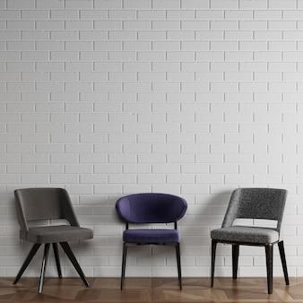 3 разных стула в современном стиле, стоящих перед белой кирпичной стеной с copyspace