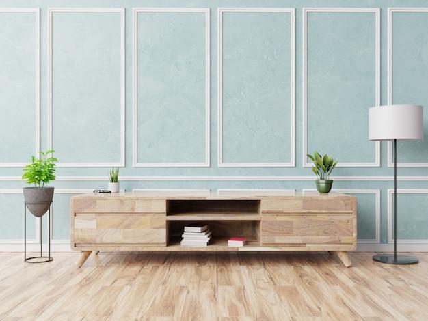 水色の壁の背景、3 dレンダリングにモダンなリビングルームのキャビネットテレビ