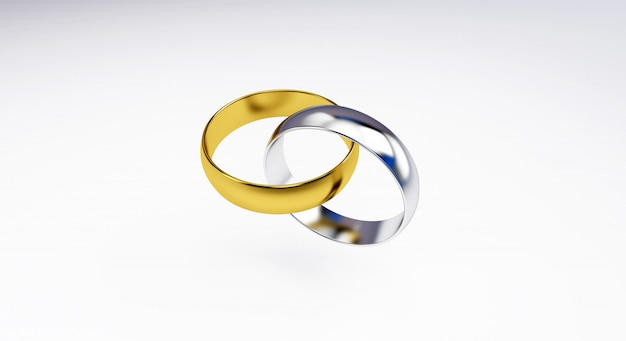 白い背景で隔離の結婚指輪の3 dレンダリング;金、銀の結婚指輪