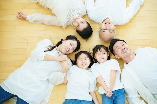 3 generation family lying on the floor in the room