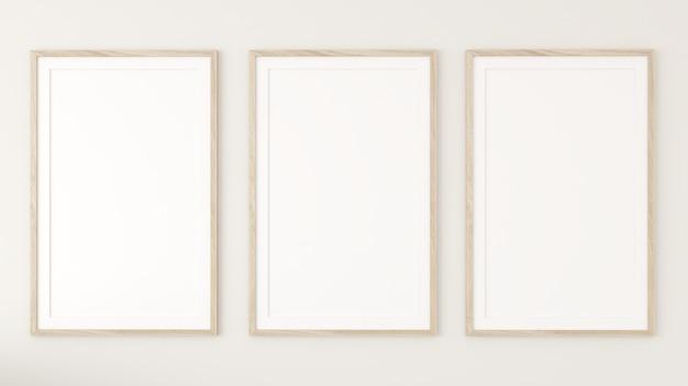 크림 벽에 3 개의 흰색 사진 프레임