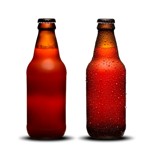 300ml beer bottles with drops and dries on white background. bock beer.