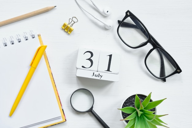 31st july - thirty first day month calendar concept on wooden blocks.