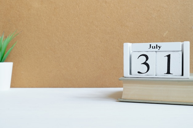 31th july - thirty-first month calendar concept on wooden blocks with copy space.