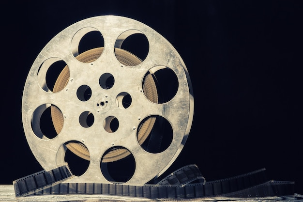 35 mm film reel with dramatic lighting on a dark.