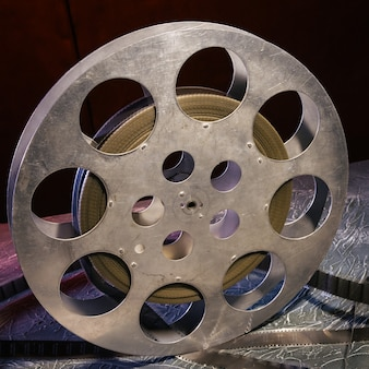 35 mm film reel with dramatic lighting on a dark