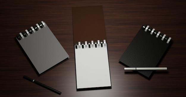 モックアップの木製テーブルの上にペンで3つのノートブック