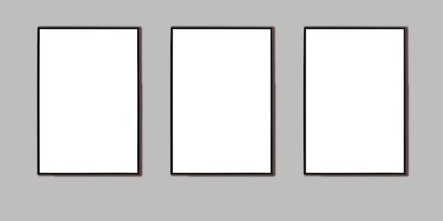 灰色の壁に写真、広告、またはポスター用の3つの黒いフレームをモックアップします。