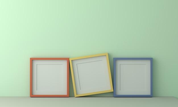 パステルライトグリーンの壁にテキストや画像を挿入するための3つのカラフルな額縁。