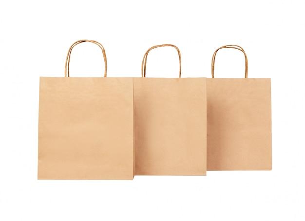 白で隔離される3つの紙袋