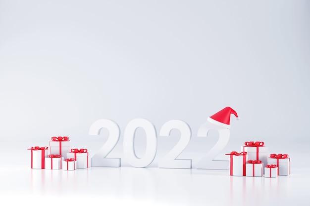 3d. шрифт 2022, шляпа санта-клауса и подарочная коробка на рождество и новый год на белом фоне