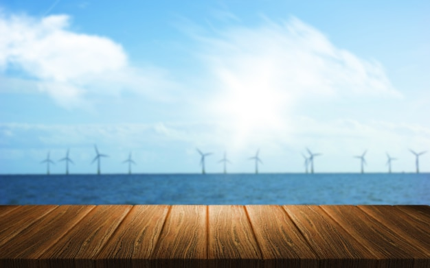 3d background of a wooden table looking out to a wind farm in the sea