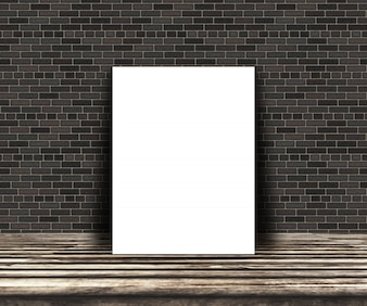 3D blank picture on a wooden table leaning against a brick wall