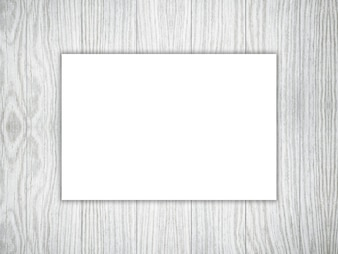 3D blank piece of white paper on a wooden texture
