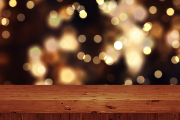 3d christmas background with wooden table against defocussed bokeh lights