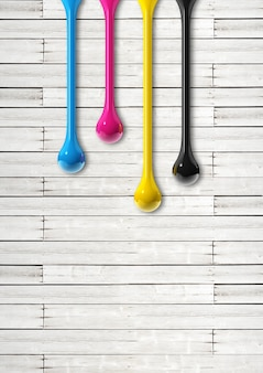 3d cmyk ink drops isolated on white wooden background. illustration