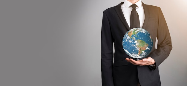 3d earth planet globe in man, woman hand, hands on blue background. environmental protection concept. elements of this image furnished by nasa