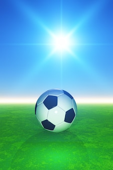 3D football on grassy pitcch against sunny blue sky