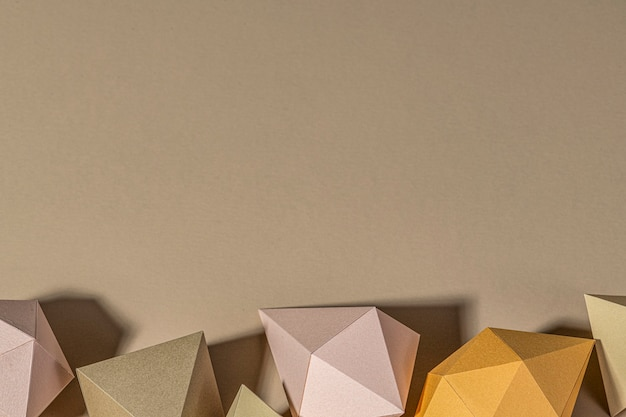 3d geometric shapes on a beige background