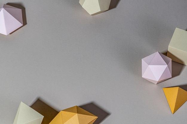 3d geometric shapes on a gray background