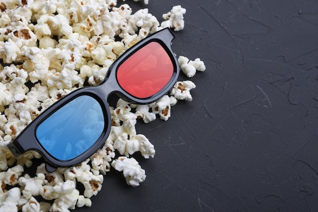 3d glasses and popcorn on the table. top view