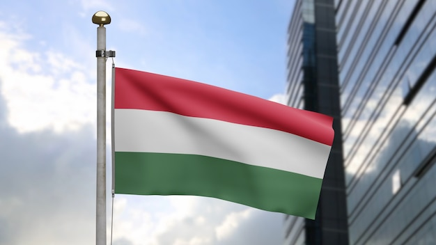 3d、現代の超高層ビルの街と風に揺れるハンガリーの旗。滑らかなシルクを吹くハンガリーのバナー。布生地のテクスチャは、背景をエンサインします。建国記念日や国の行事のコンセプトに使用してください。