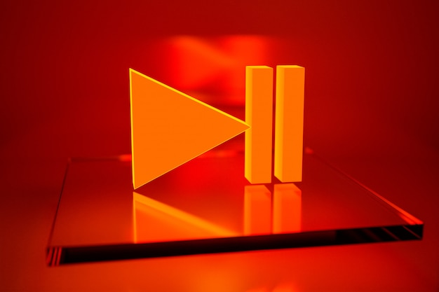3d illustration button to turn on music on orange background. video and music player start and stop button sign . play design element
