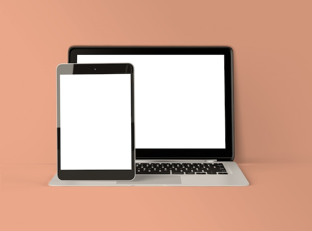 3d illustration. laptop and digital tablet with white screen.