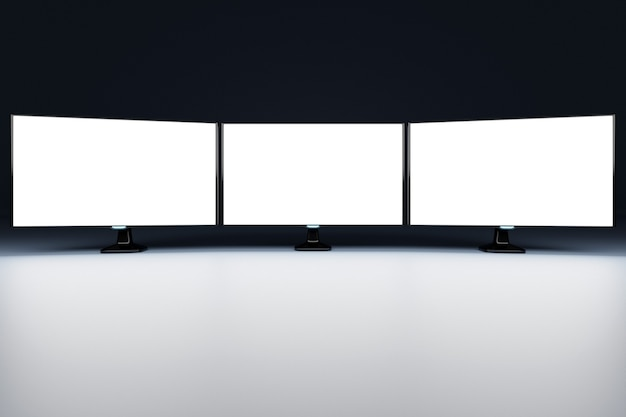 3d illustration mock up of a three monitors with  white screen in black room