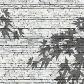 3d leaves shadows on a brick wall texture