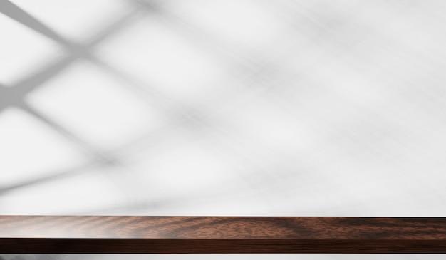 흰 벽 배경에 그림자와 나무 테이블 탑의 3d. 몽타주 제품 전시용.