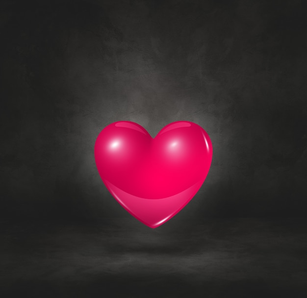 3d pink heart isolated on a black studio background. 3d illustration