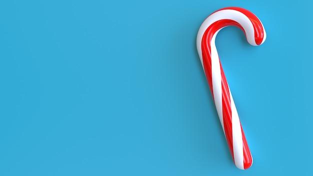 青い背景に3dレンダリングクリスマスロリポップ