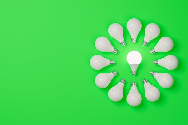 明るい緑の背景に、真ん中の 1 つだけが点灯している電球の 3 d レンダリング サークル