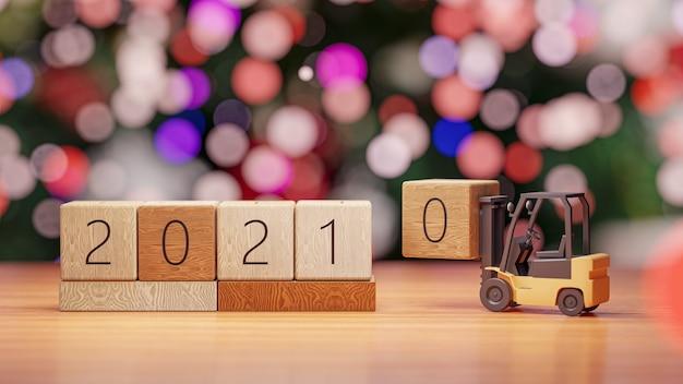 3d 렌더링. 지게차 새 해와 크리스마스 벽에 2021 년 나무 블록을 들어 올립니다.