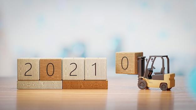 3d 렌더링. 지게차는 새해 andchristmas 벽에 2021 년 나무 블록을 들어 올립니다.