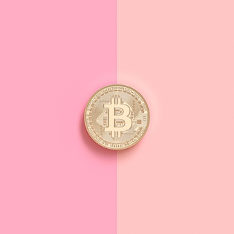 3d render image of a gold bitcoin coin on a pink surface