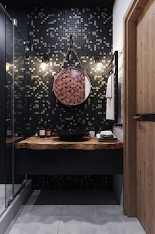 3d визуализация. интерьер современной ванной комнаты с черно-серой мозаикой на стене.