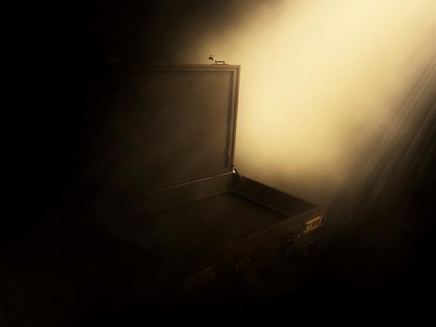 開いているブリーフケースに光り輝く光線の3dレンダリング