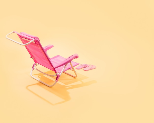 3d render pink beach chair and pink flip flops back view on yellow background