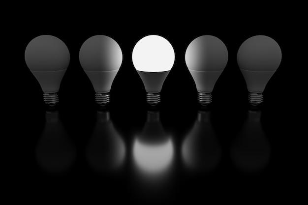 電球の 3 d レンダリング セットと中央の電球が黒い背景に点灯しています