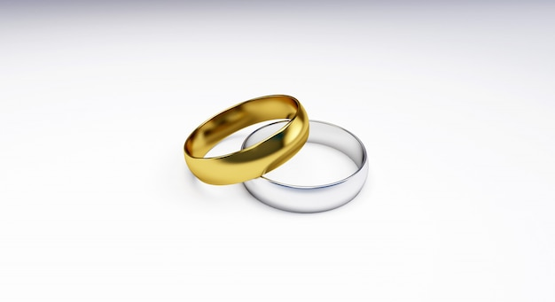 3d render of wedding rings isolated on white background; wedding rings of gold, silver