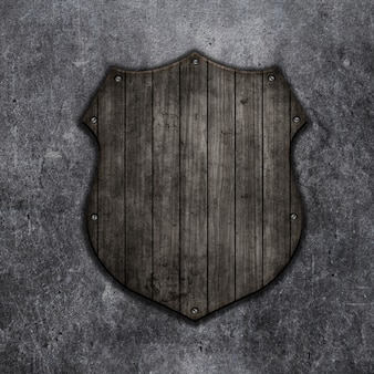 3d render of a wooden shield on a grunge background