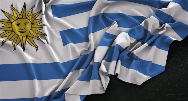 Уругвайский флагов, сморщенный на темном фоне 3d render