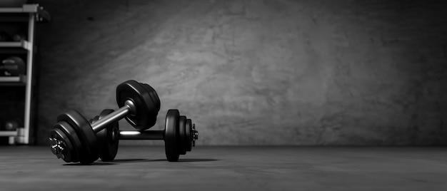 3dレンダリング、後ろにトレーニング機器を備えた暗いコンセプトのフィットネスルームの床に黒いダンベル