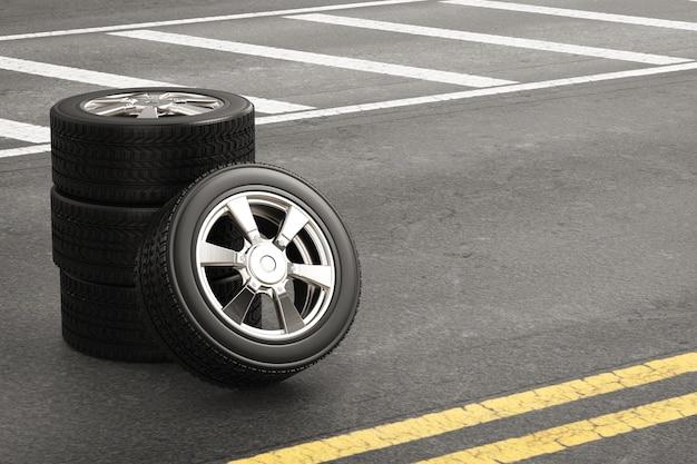 路上で合金ホイールと黒のタイヤをレンダリングする3d
