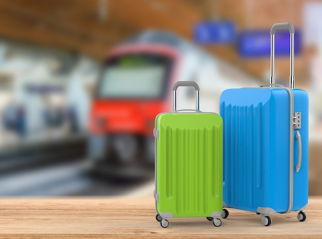 地下鉄の背景を持つ青と緑のハードケースの荷物を3dレンダリング