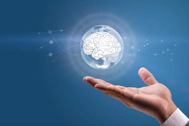 治療の世話をしながら手で脳に触れる3dレンダリング医師の手