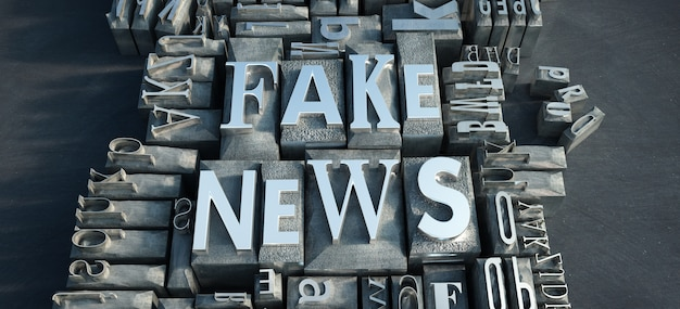 3d rendering of a group of metallic printing letters and the words fake news